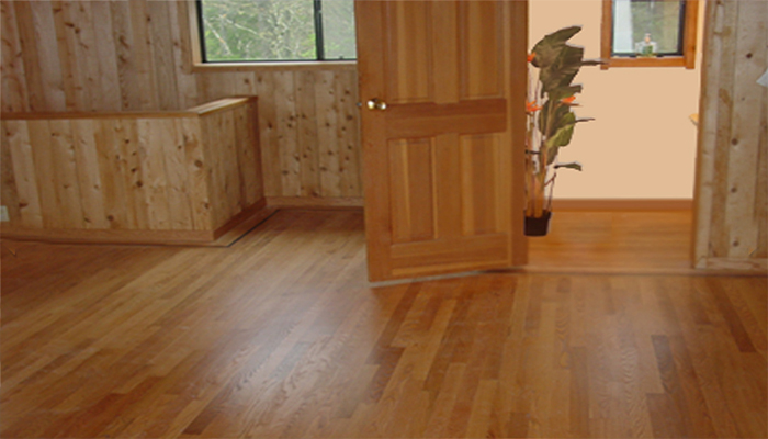 Solid red oak flooring throughout this California country home enhances its relaxing rural ambience.