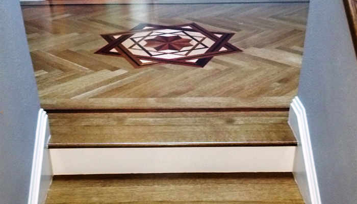 Matching strips of solid rift-cut white oak supply an additional splash of style to the stairway.