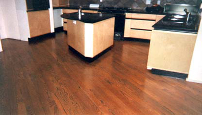 This angled one direction floor of select southern oak and stained rosewood gives new meaning to the phrase dream kitchen.