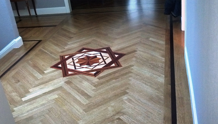 A single mahogany feature strip both sets off and accentuates the white oak herringbone design.